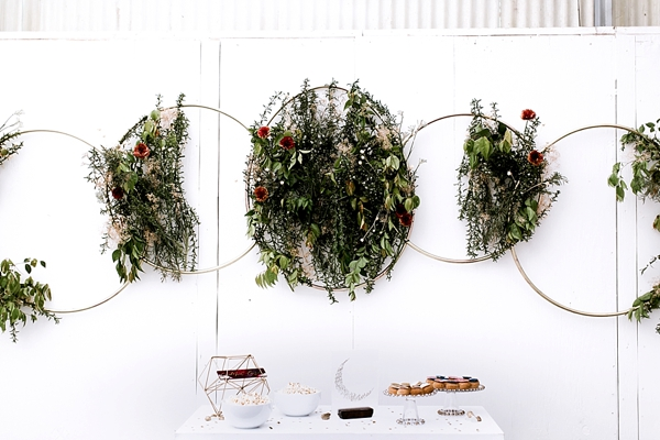 Modern wedding ceremony backdrop with rings and creative botanical phases of the moon