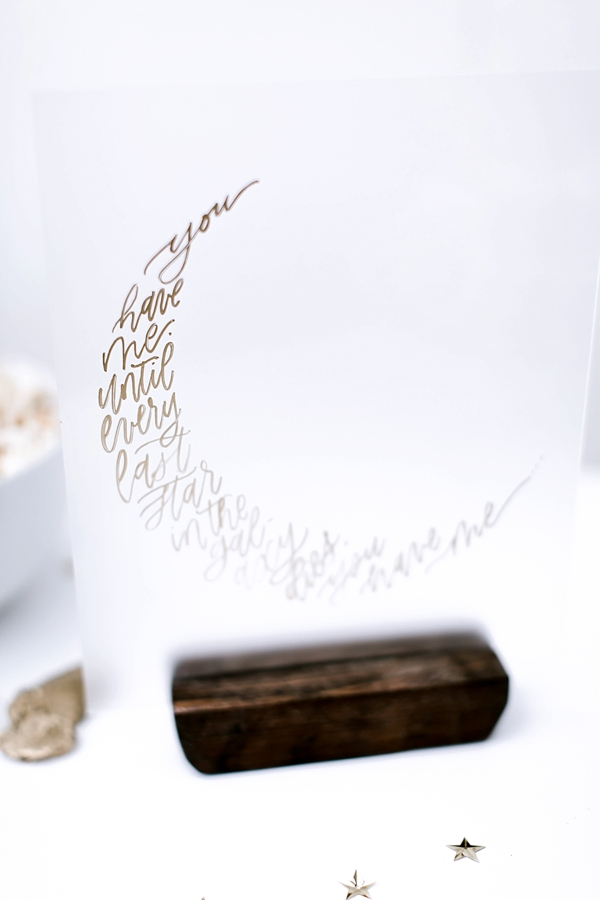 Calligraphy quote in the shape of a crescent moon for celestial wedding