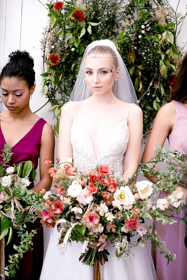 Celestial bride and her bridesmaids in Davids Bridal dresses