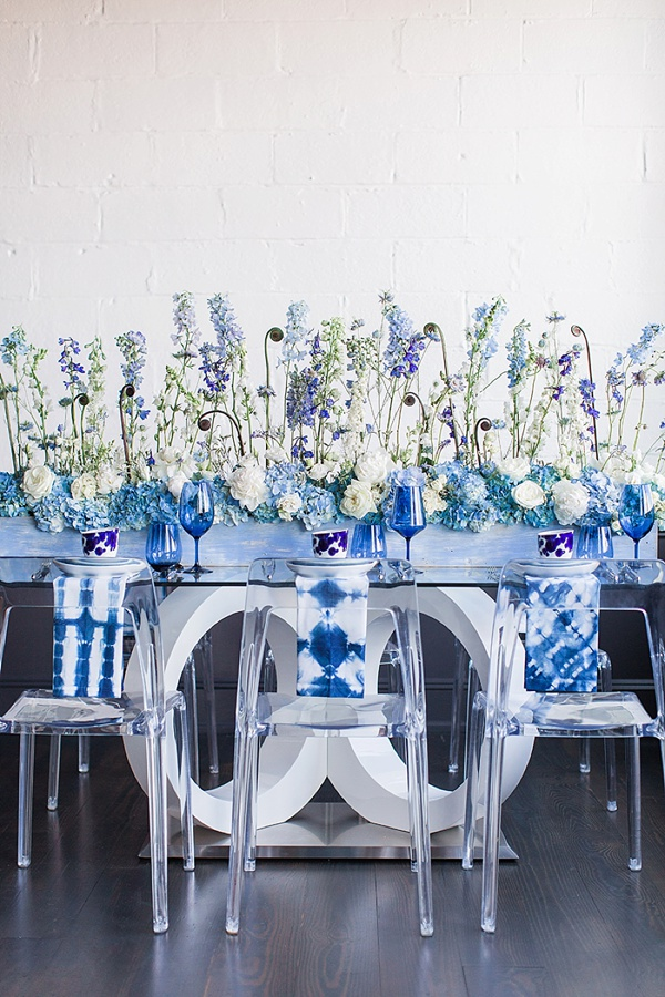 Long blue wedding centerpiece with high and low flowers