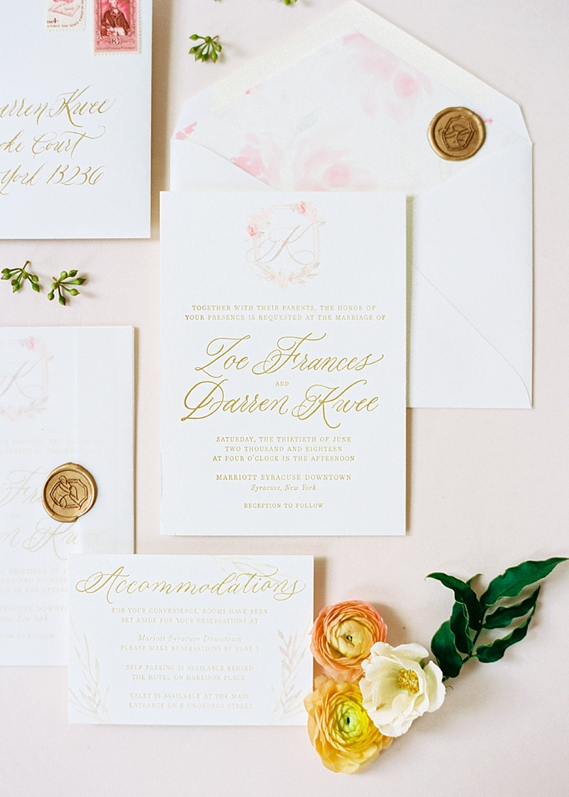 Wedding invitation suite with pink and gold lettering