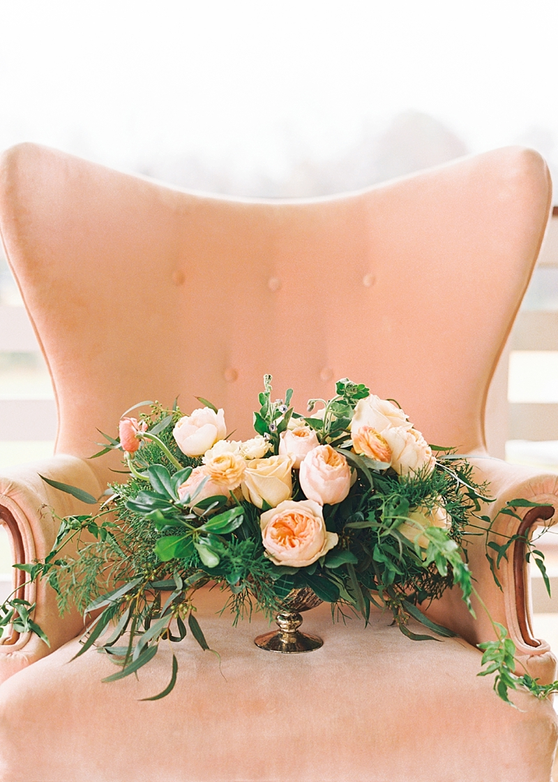 Romantic pink wedding centerpiece with overflowing greenery