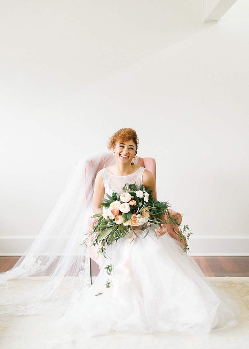 Long cathedral veil and blush pink bouquet for modern romantic bride