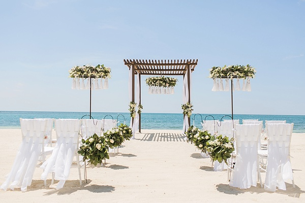 Gorgeous beach ceremony arch with pergola and giant white tassels