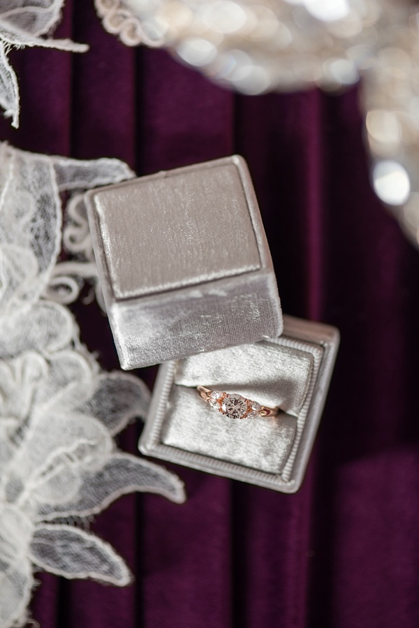 Gray velvet wedding ring box with a rose gold diamond engagement ring for a classic look