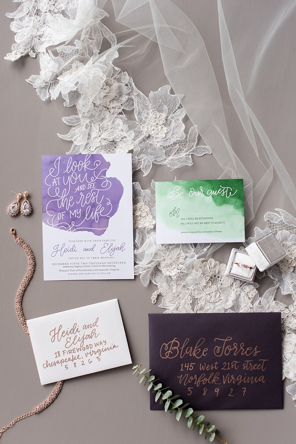 Green and purple calligraphy wedding invitation suite with plum colored envelope