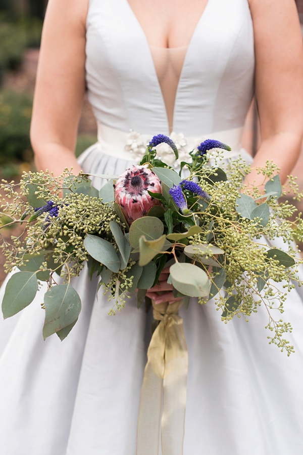 Simple eucalyptus wedding bouquet with protea and purple veronica flowers
