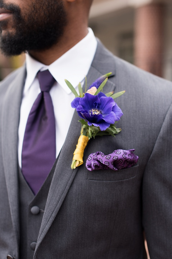 Ultraviolet purple anemone boutonniere for autumn and trendy classic wedding