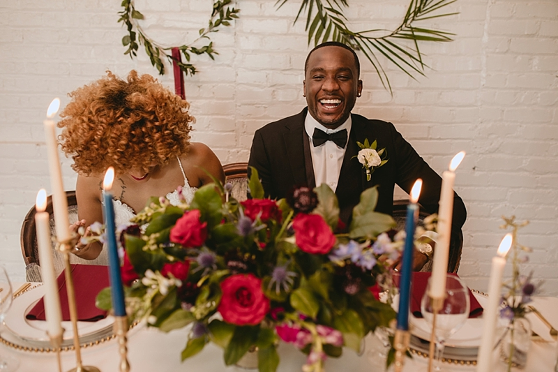 Handsome black groom with bow tie and stylish black tuxedo