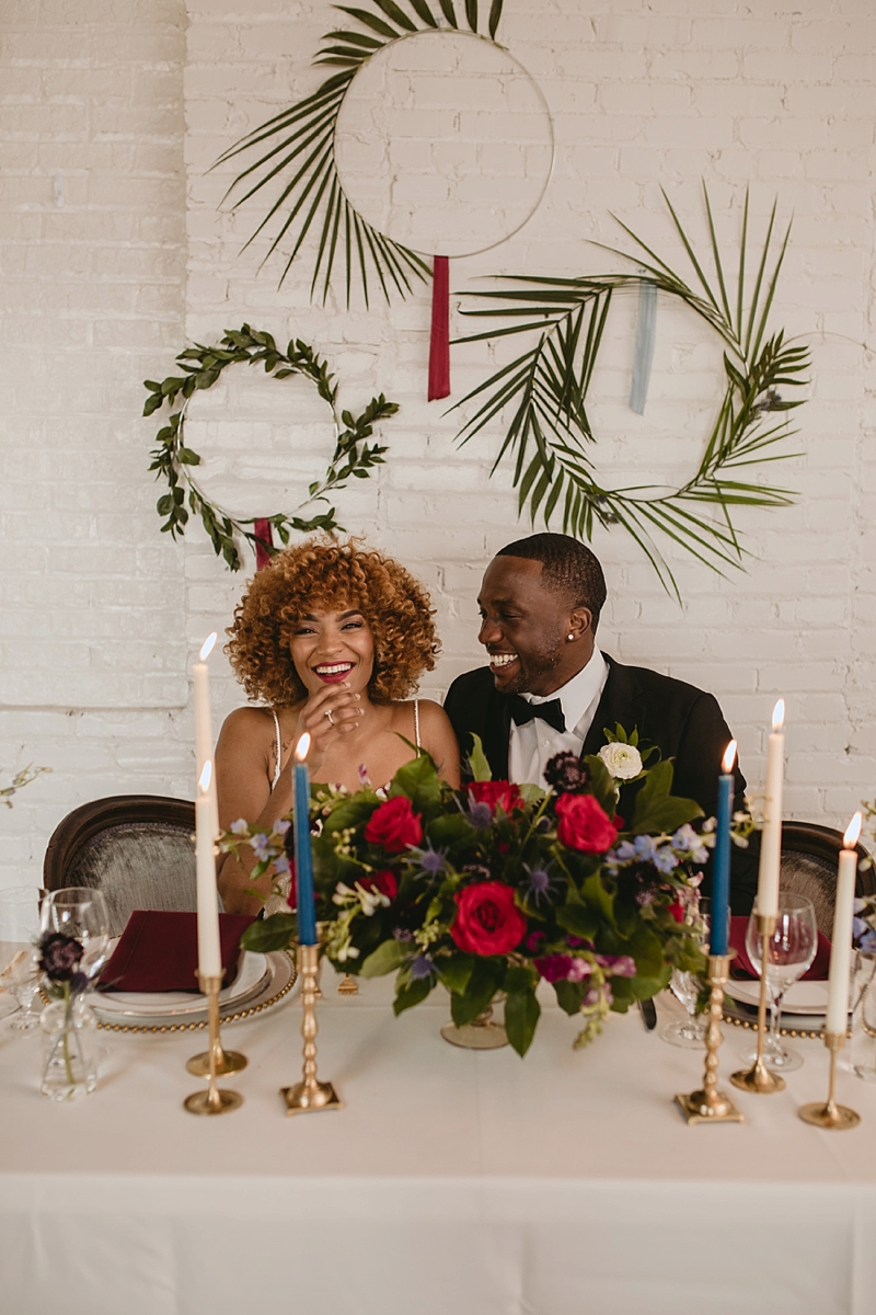 Gorgeous black bride and groom with vintage boho wedding decor ideas and trendy wreaths