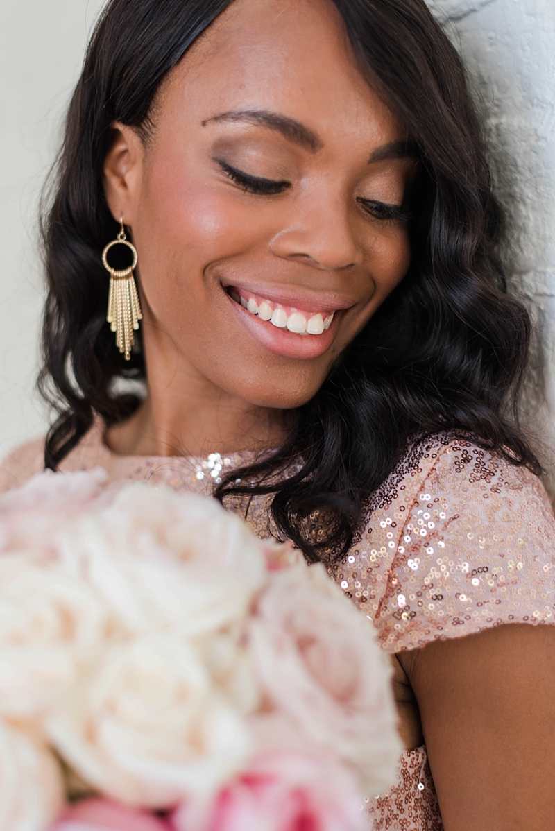 Natural yet shimmery makeup look for bridesmaid wearing pink sequins