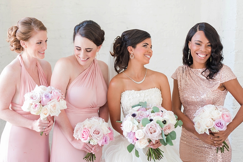 Bridesmaids in different pink dresses and sequins