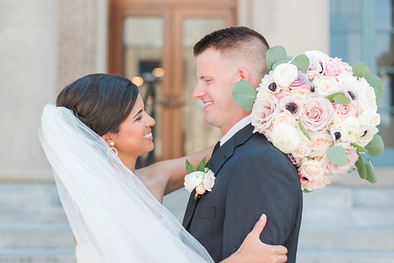 Bride and groom sharing a sweet moment at Historic Post Office in Hampton Virginia