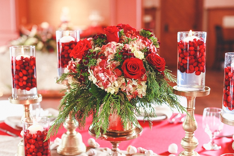 Red and green Christmas wedding centerpiece with roses and hydrangeas