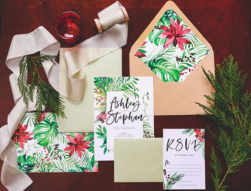 Tropical Christmas wedding invitations with palm leaves and poinsettias
