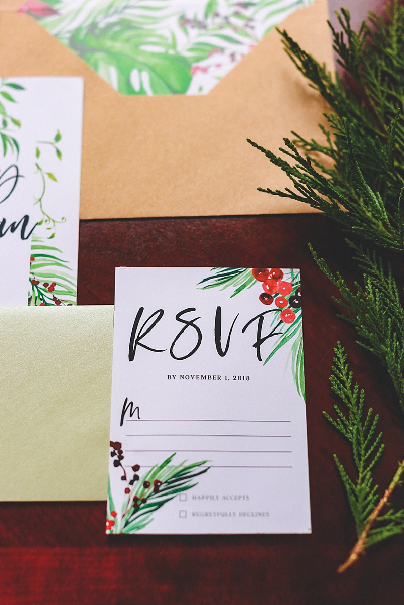 Red and green tropical inspired holiday wedding invitation suite