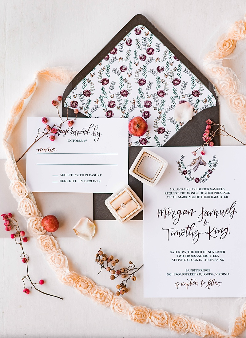 Horse inspired wedding invitation with laurel wreath emblem