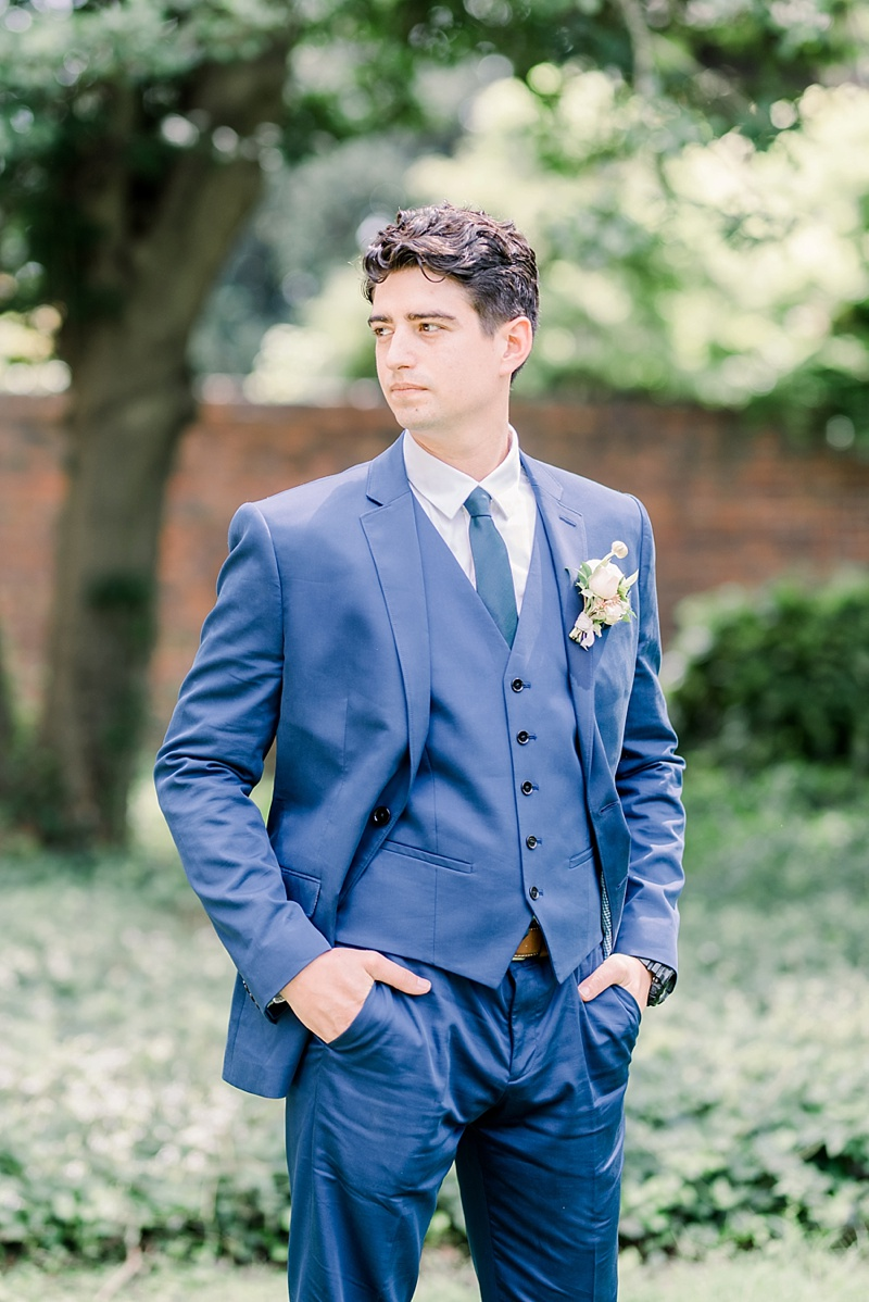Groom in handsome blue suit for a French inspired wedding