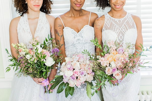 Diverse bridal bouquets of pink and purple roses and greenery