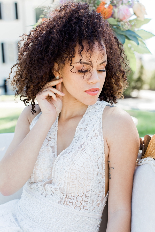 Curly natural hair with soft neutral bridal makeup