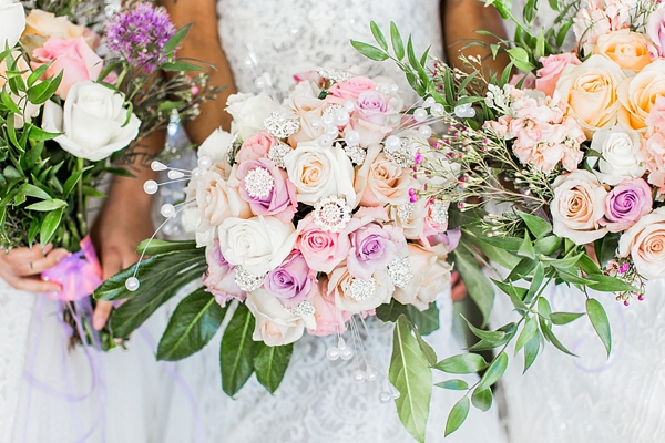 Pink and orange wedding flowers with crystal gem details
