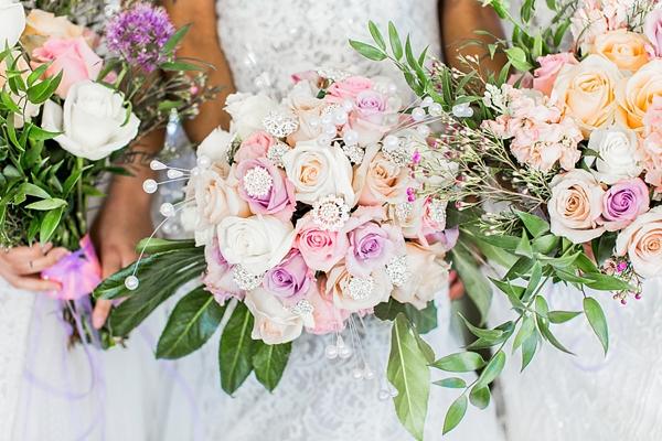 Pink and orange wedding flowers with crystal gem details