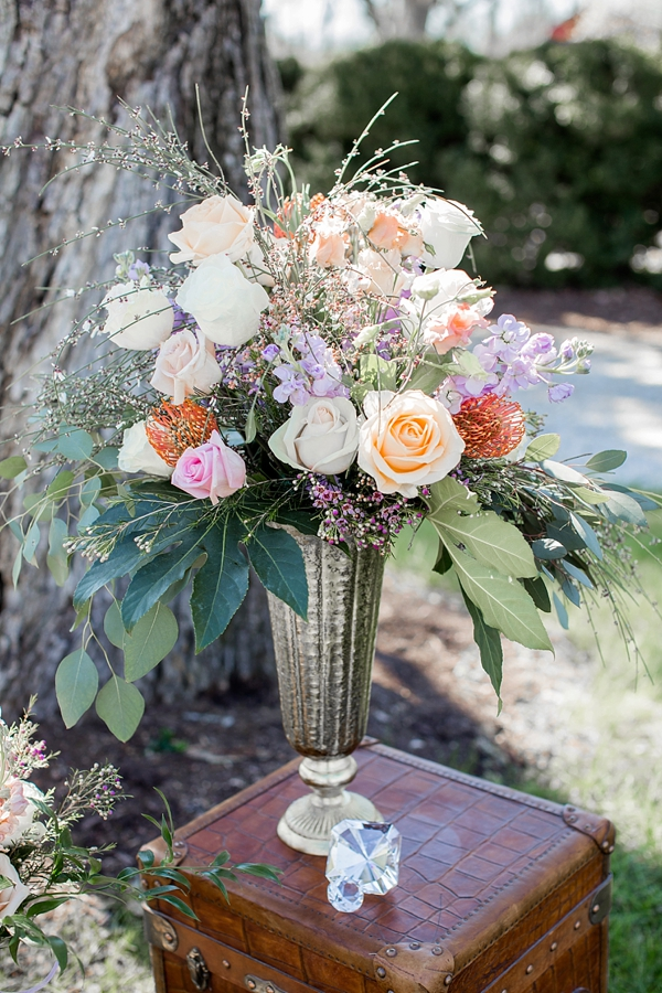 Tall wedding centerpiece with pincushion proteas and roses