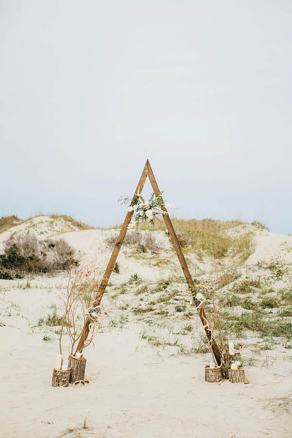 Modern triangle arch for indie beach wedding