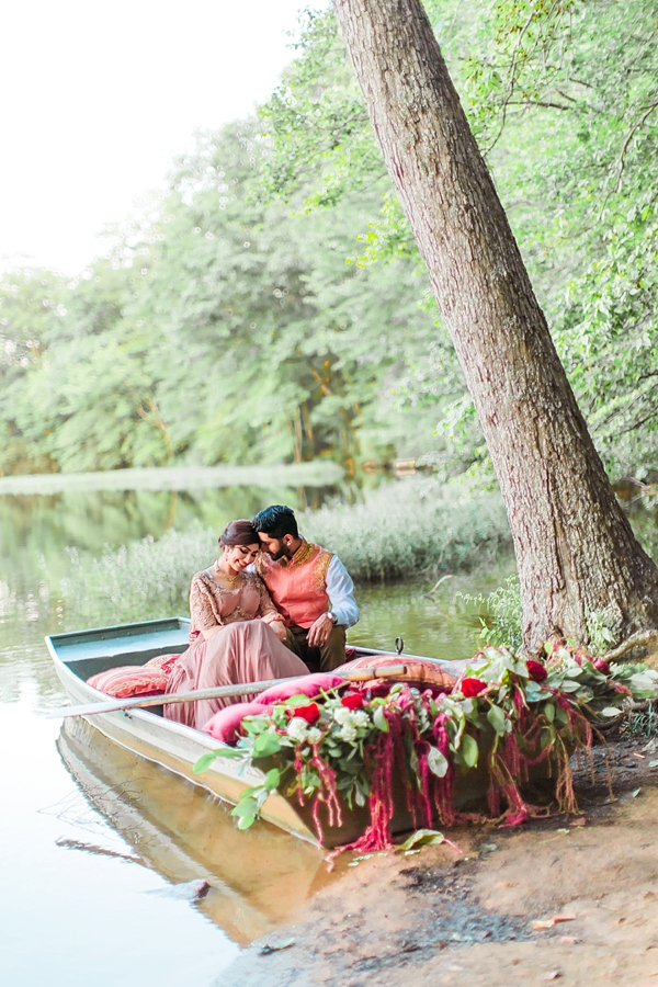 Modern Indian wedding ideas with a rowboat filled with pink and red flowers