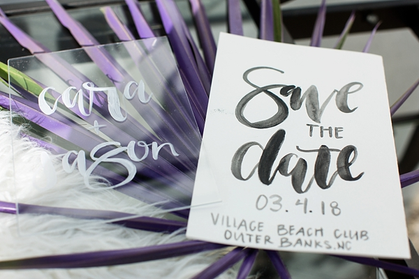 Handlettered wedding save the date on clear acrylic