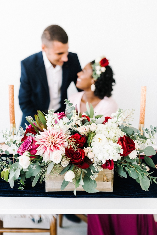 Red and blush pink flowers for a modern wedding centerpiece