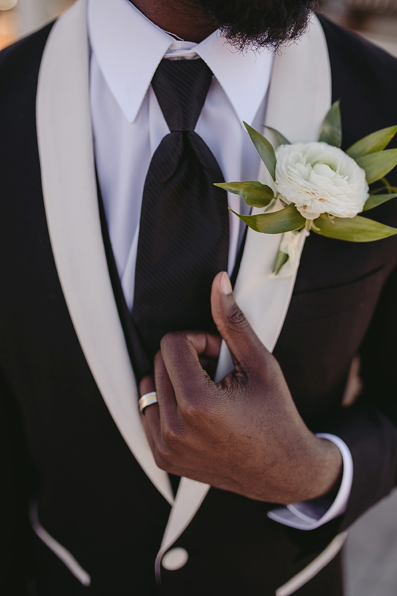 Simple white boutonniere for tropical groom