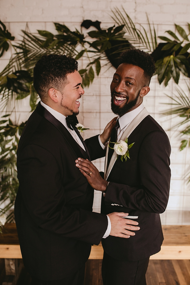 Two handsome diverse grooms for a beautiful tropical wedding