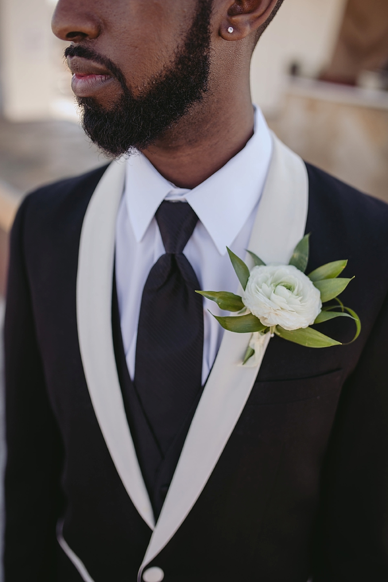 Duo tone tuxedo with white cowl collar for stylish modern groom