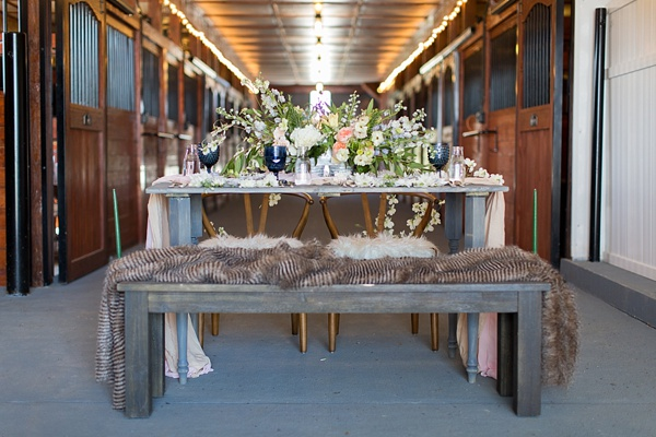 Rustic furniture with bench seating for a prairie inspired wedding