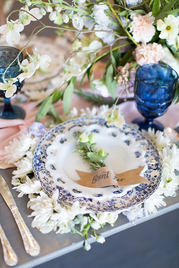 Vintage plates on unique floral charger for rustic wedding