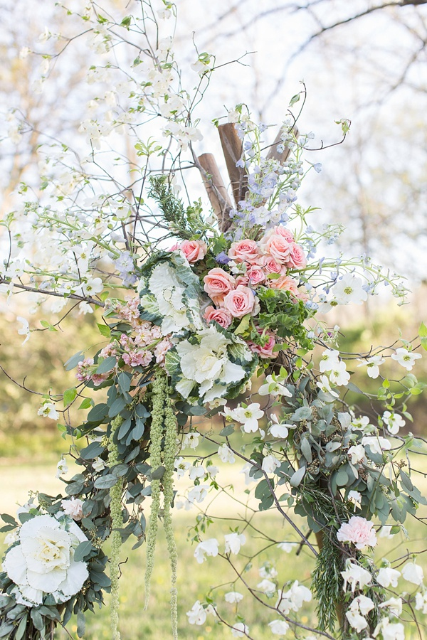 Wildflowers and dogwood flowers for floral teepee decor