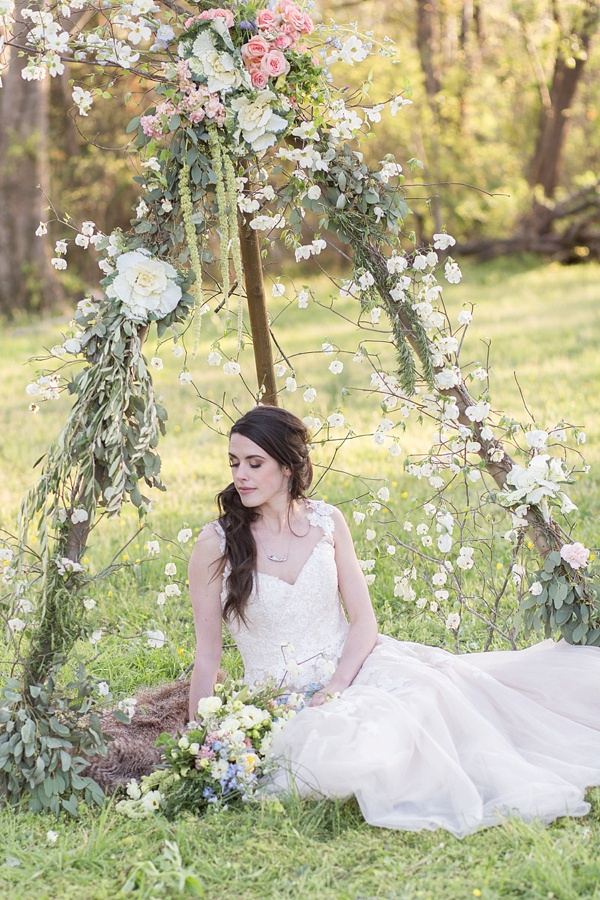 Rustic floral teepee with wildflowers all around