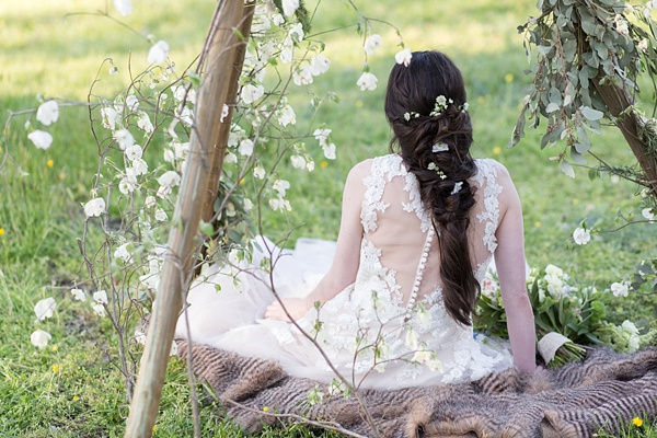 Long bridal braid with loose white flowers