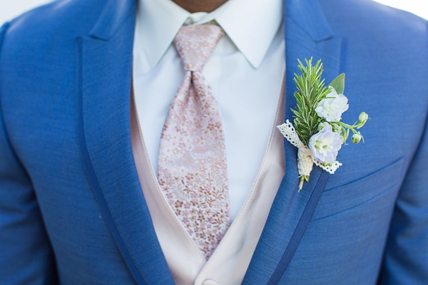 Sweet blue suit for the groom with pale pink floral necktie