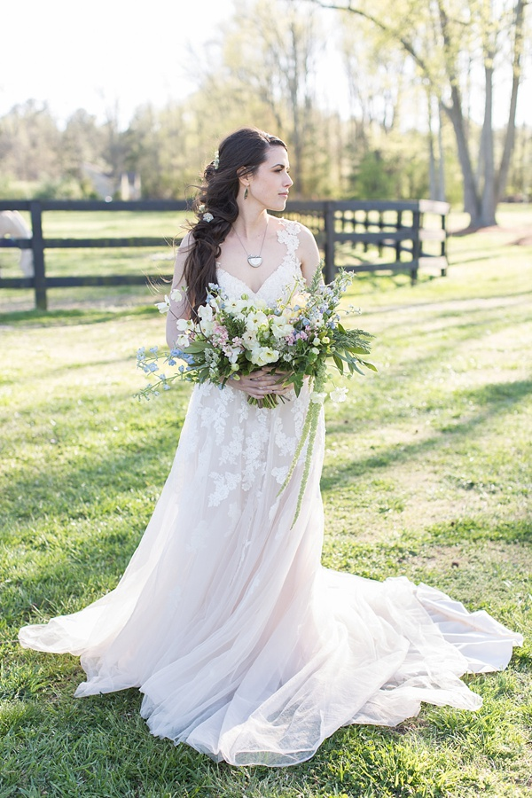 Flowy white wedding dress and wildly foraged bridal bouquet with dogwood flowers