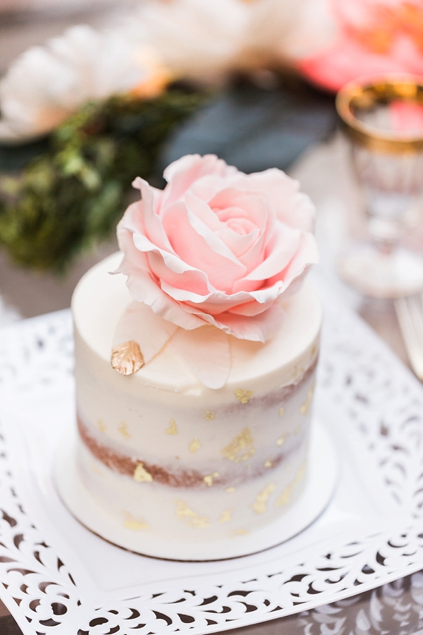 Tiny wedding cake with sugar feathers and gold flecks