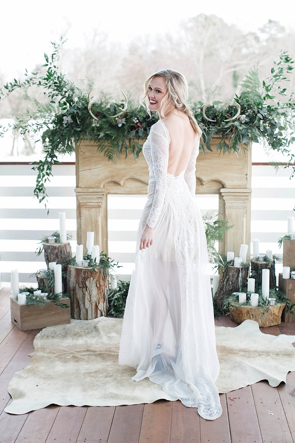 Rustic chic winter wedding ceremony ideas with antlers and greenery