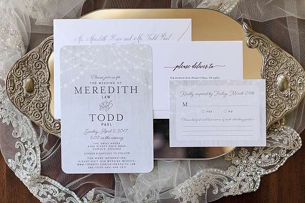 Rustic wedding invitations with bistro lights and wood texture