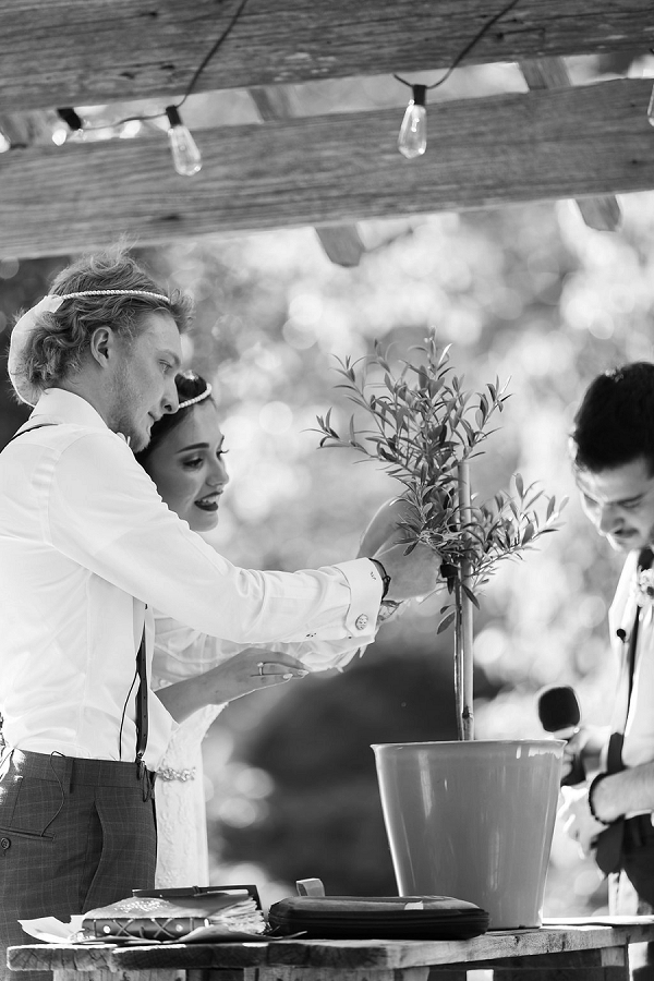 Watering the unity tree for a unique rustic wedding ceremony