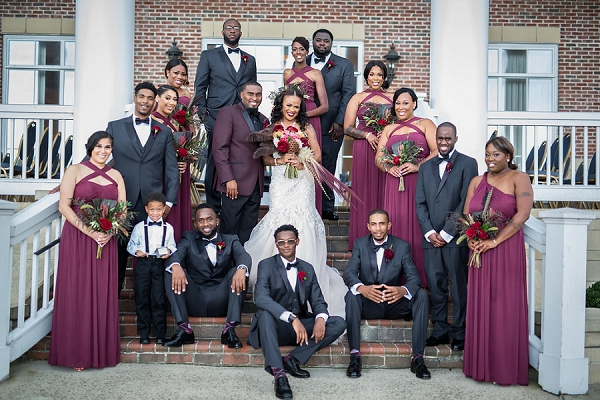 Wine colored bridesmaid dresses and groomsmen boutonnieres