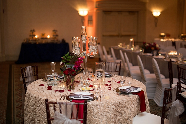Textured linens and crimson red napkins for classic sweetheart wedding table
