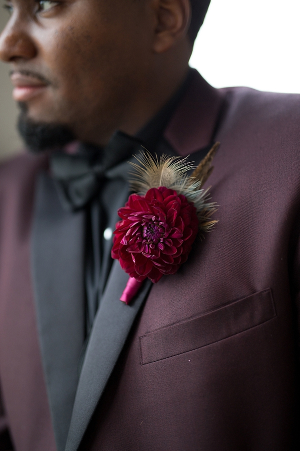 Burgundy red groom boutonniere