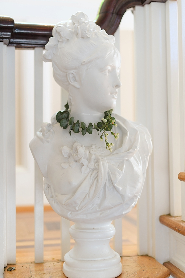 Classic white statue with wedding flower crown