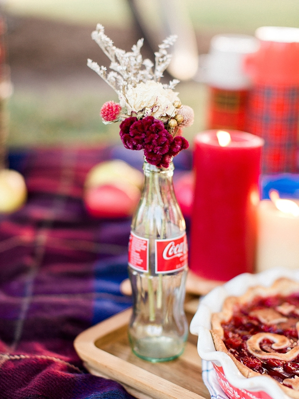 Adorable glass Coca Cola bottle filled with red and white flowers